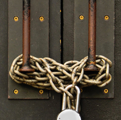 Chained door with padlock