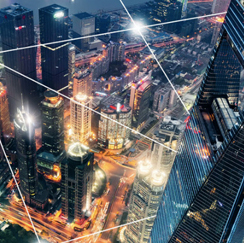 Cityscape at night with light connections, aerial view