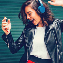 Girl with blue headphones on dancing