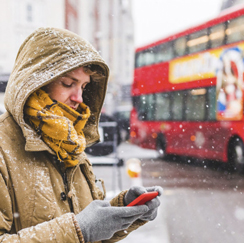 Person with phone in the snow