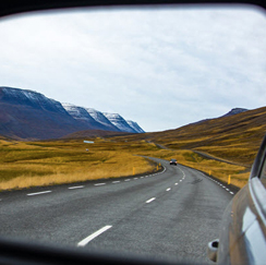 View of road through rear-view mirror