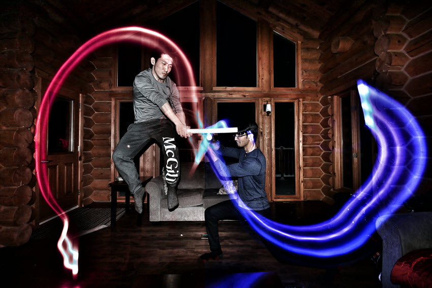 Two men with red and blue light swords