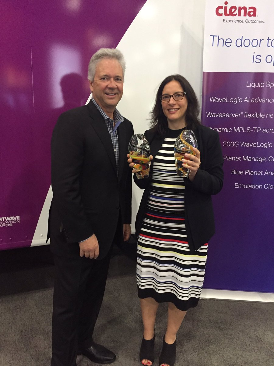 Ciena's Helen Xenos accepts two Lightwave Innovation Awards from Rob Stuehrk at Lightwave
