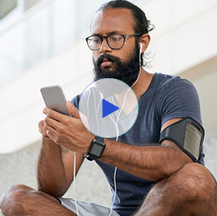 Man with earphones looking at phone