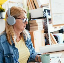 Woman wearing headphones on conference call