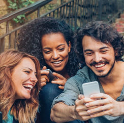 Group of people laughing with phone