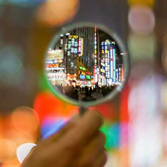 Magnifying glass looking at city
