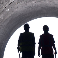 Silhouettes of workers in tunnel