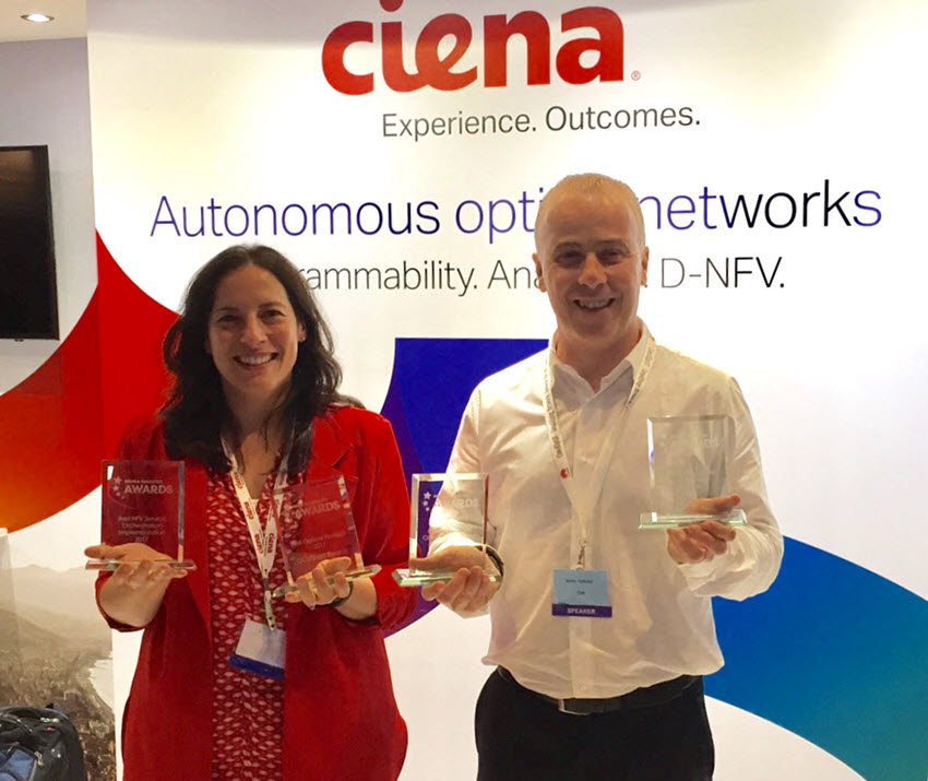 Ciena's Helen Xenos and Mirko Voltolini from Colt show off the four combined awardds the two companies took home from NGON 2017.