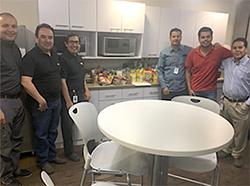 Ciena volunteers standing in breakroom