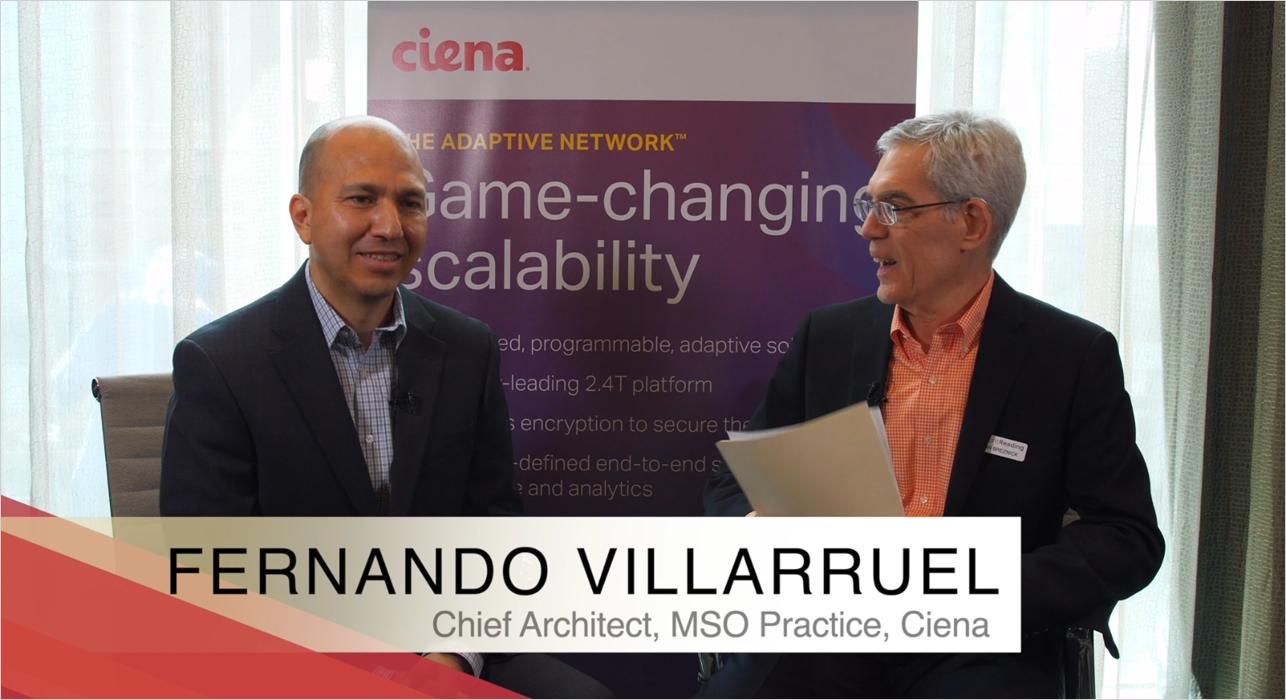Ciena's Fernando Villarruel talking to Alan Breznick