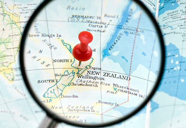 Magnifying glass on map of New Zealand